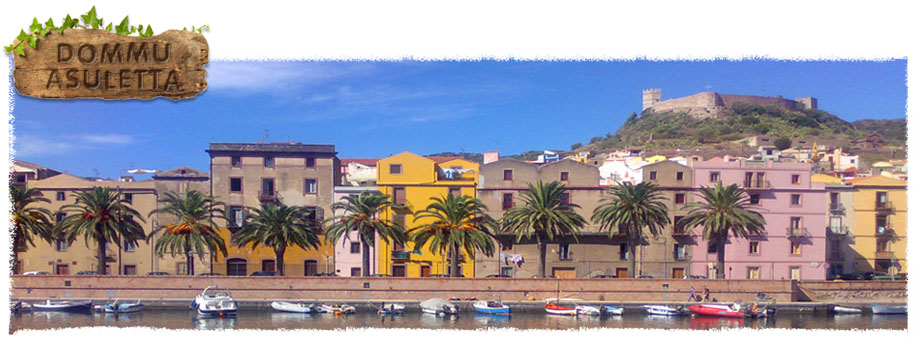 A riverside view of Bosa, Sardinia with the medieval castle 'Castello Malaspina' presiding over it.